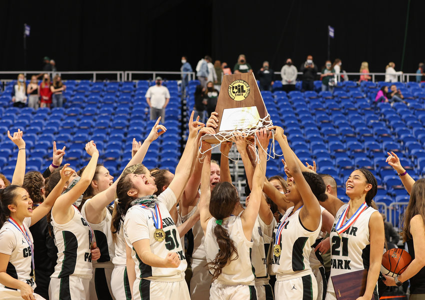 The Cedar Park Timberwolves hold the state championship trophy after a 46-39 win in the Class 5A state title game against Frisco Liberty on March 10, 2021 in San Antonio, Texas.