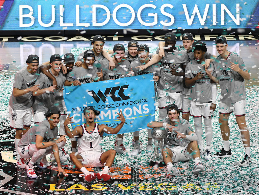 The Gonzaga Bulldogs celebrate on the court after their 88-78 victory over the Brigham Young Cougars to win the championship game of the West Coast Conference basketball tournament at the Orleans Arena on March 9, 2021 in Las Vegas, Nevada.  (Ethan Miller/Getty Images/TNS)