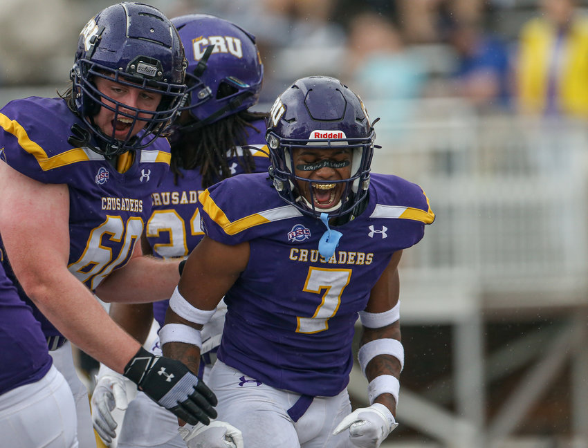 UMHB Crusaders wide receiver K.J. Miller (7) reacts after scoring a touchdown during an NCAA football game between the University of Mary Hardin-Baylor and Southwestern University on February 27, 2021 in Belton, Texas.