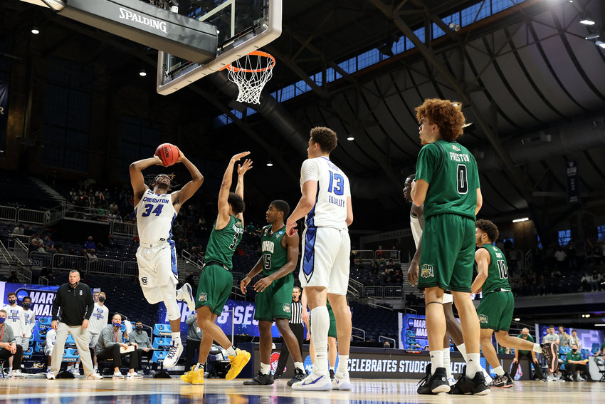 Denzel Mahoney #34 of the Creighton Bluejays goes up for a shot against the Ohio Bobcats in the second half of their second round game of the 2021 NCAA Men's Basketball Tournament at Hinkle Fieldhouse on March 22, 2021 in Indianapolis, Indiana. (Andy Lyons/Getty Images/TNS)