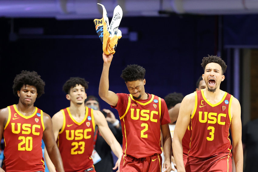 Isaiah Mobley #3, Tahj Eaddy #2, Max Agbonkpolo #23 and Ethan Anderson #20 of the USC Trojans react in the second half of their second round game win over the Kansas Jayhawks in the 2021 NCAA Men's Basketball Tournament at Hinkle Fieldhouse on March 22, 2021 in Indianapolis, Indiana. (Andy Lyons/Getty Images/TNS)