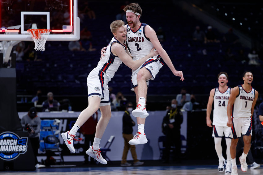 Martynas Arlauskas (5) and Drew Timme (2) of the Gonzaga Bulldogs celebrate defeating the USC Trojans 85-66 in the Elite Eight round game of the 2021 NCAA Men's Basketball Tournament at Lucas Oil Stadium on March 30, 2021 in Indianapolis, Indiana. (Jamie Squire/Getty Images/TNS)
