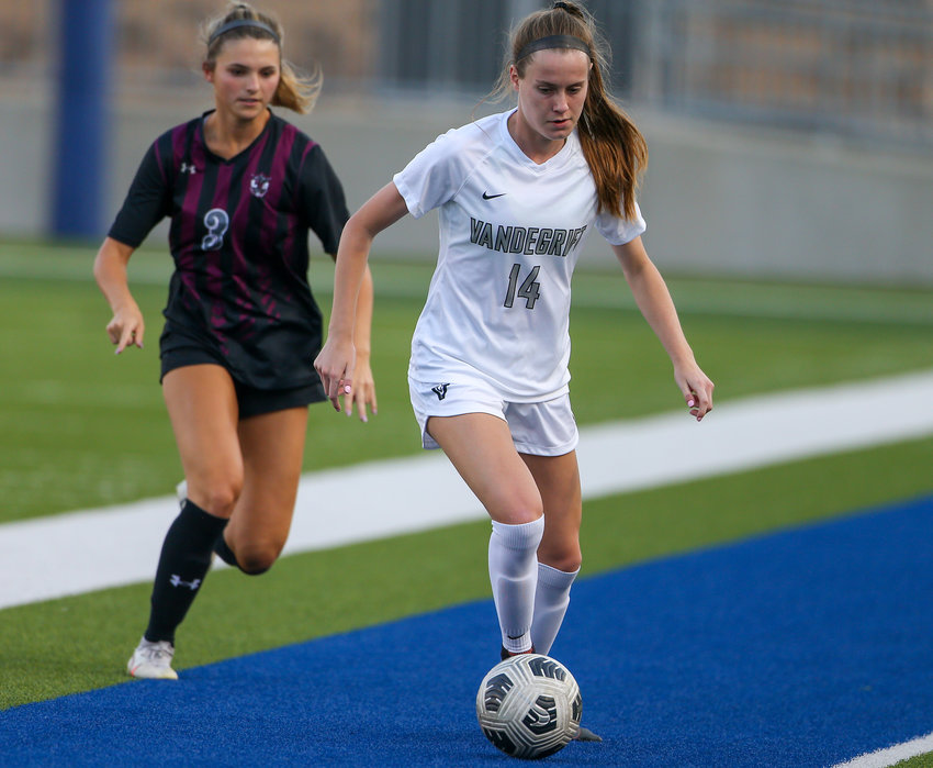Vandegrift Vipers senior forward Lily Spencer (14) during a high school girls soccer playoff between Round Rock and Vandegrift on April 9, 2021 in Pflugerville, Texas.