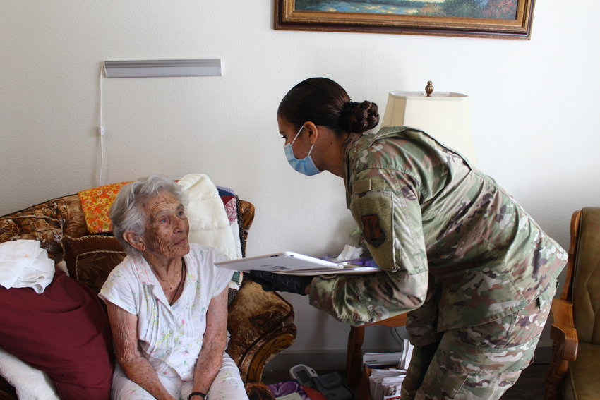A member of the National Guard vaccinates a home bound senior in Williamson County last week.