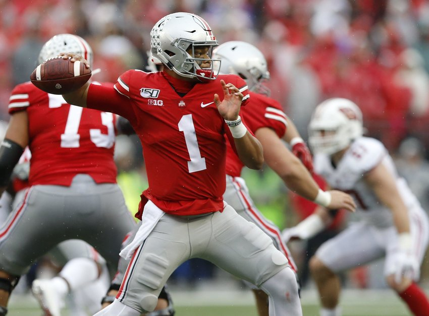 Justin Fields, Ohio State's quarterback, is expected to be a high draft pick. (Adam Cairns/Columbus Dispatch/TNS)