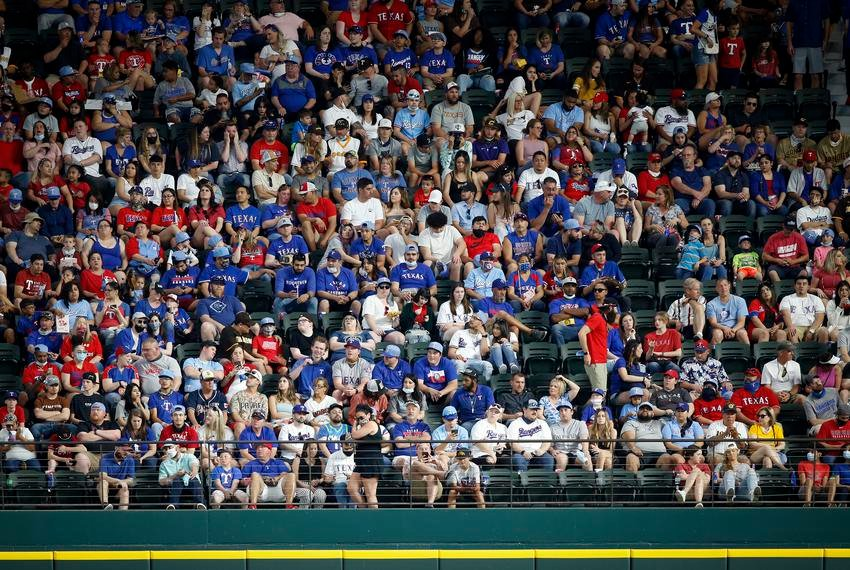 Fans watched a game between the Texas Rangers and the San Diego Padres at Globe Life Field on April 11, 2021. There's a race going on, between the desire to return to a pre-pandemic normal and to get enough Texans immunized to make that a safe proposition. Tim Heitman/USA TODAY Sports via REUTERS