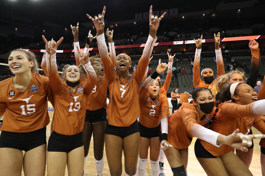 OMAHA, NE - APRIL 22: The Texas Longhorns celebrate winning against the Wisconsin Badgers during the Division I Women's Volleyball Semifinals held at the Chi Health Center on April 22, 2021 in Omaha, Nebraska. (Photo by Jamie Schwaberow/NCAA Photos via Getty Images)