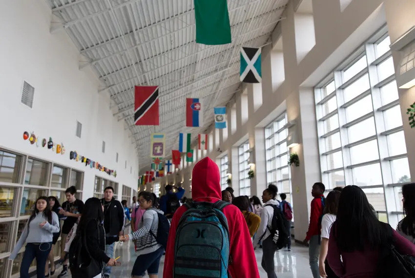 High school students walk to their next class after the bell rings at Elsik Ninth Grade Center in Houston in 2018.
