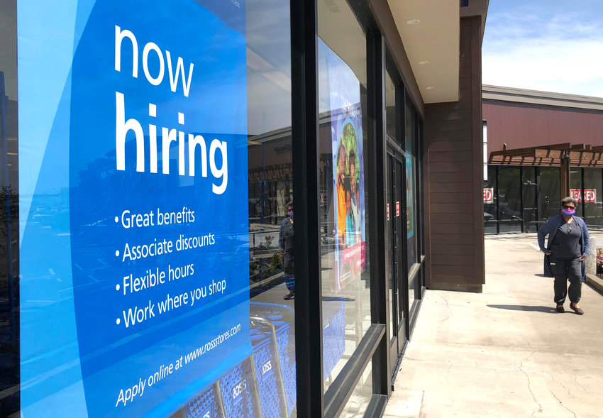 A pedestrian walks by a now hiring sign at Ross Dress For Less store on April 02, 2021, in San Rafael, California. (Justin Sullivan/Getty Images/TNS)