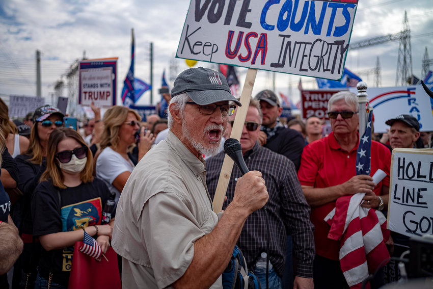 Supporters of U.S. President Donald Trump protest in front of  the Maricopa County Election Department while votes are counted in Phoenix on Nov. 6, 2020. (Olivier Touron/AFP/Getty Images/TNS)