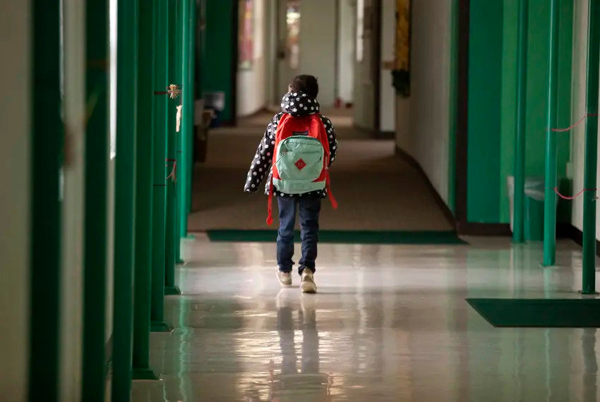A student walks down the hallway at Cactus Elementary School in Cactus.
