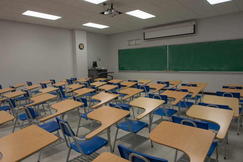 States are debating whether to hold back students who are struggling academically, or let them move on. (Dreamstime/TNS)