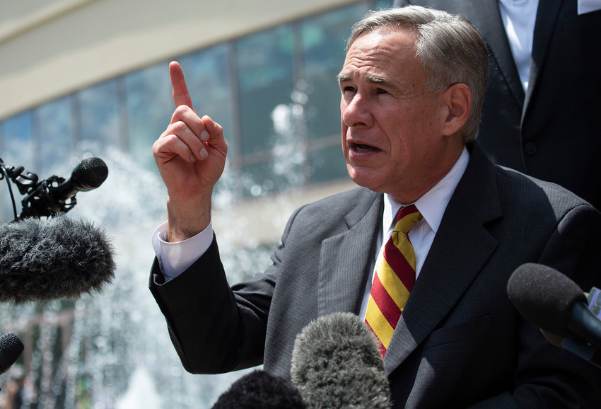 Texas Gov. Gregg Abbott speaks to the press after attending the public viewing for George Floyd at the Fountain of Praise church in Houston, Texas on June 8, 2020. (Andrew Caballero-Reynolds/AFP/Getty Images/TNS)