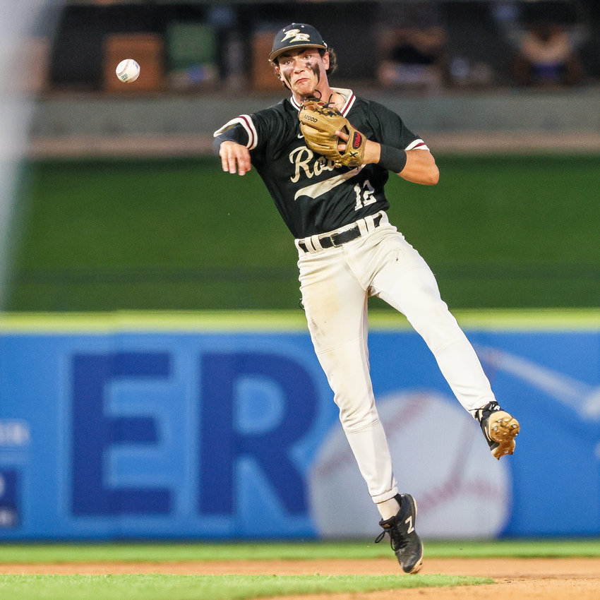 Shortstop Joe Sparschu (12) throws to first base in the UIL State 5A Semifinal Championship baseball game between the Hallsville Bobcats and Rouse Raiders.  The game was played on Thursday, June 10, 2021, at Dell Diamond in Round Rock, Texas  (Andy Nietupski for Hill Country News)