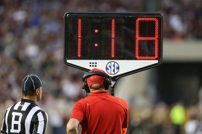 Game officials hold the television timeout clock during a during an NCAA football game between Texas A&M and Kentucky on Saturday, Oct. 6, 2018 in College Station, Texas. Texas A&M won, 20-14 in overtime.