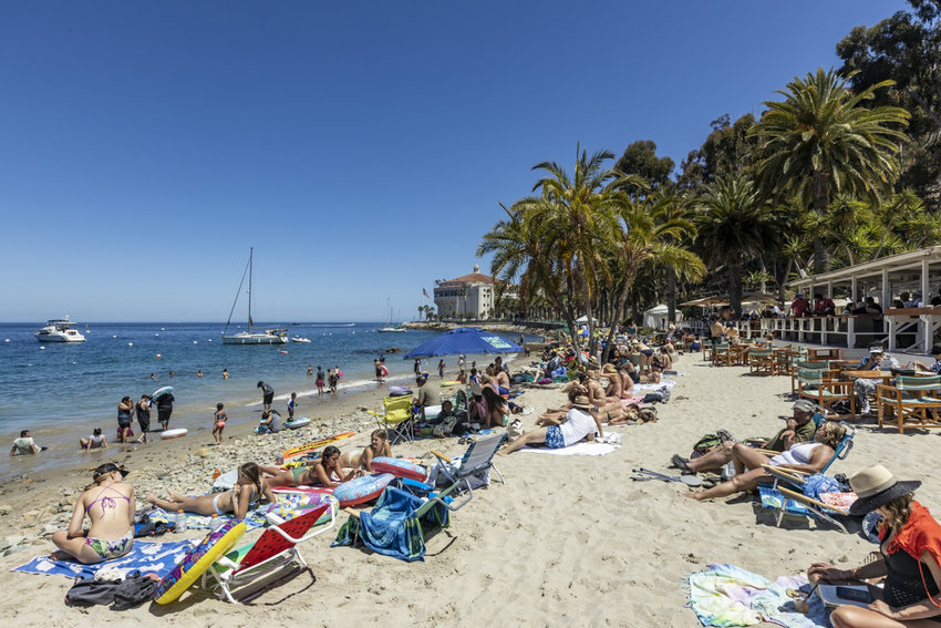 Beachgoers relax at the Descanso Beach Club last month on Catalina Island on Friday, June 25, 2021. (Allen J. Schaben/Los Angeles Times/TNS)