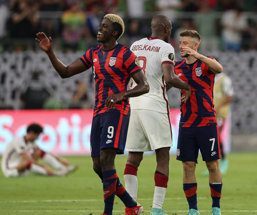 United States forward GYASI ZARDES (9) and midfielder PAUL ARRIOLA (7) celebrate a 1-0 victory over Qatar in a Concacaf Gold Cup semifinal on July 29, 2021 in Austin, Texas. The United States won 1-0. Arriola scored the lone goal in the match.
