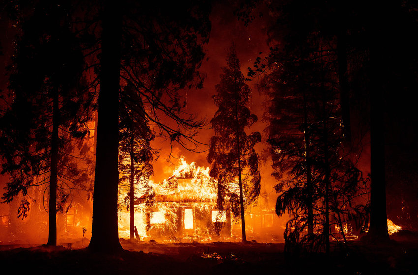 A home burns as flames from the Dixie fire tear through the Indian Falls neighborhood of unincorporated Plumas County, California on Saturday, July 24, 2021. (Josh Edelson/AFP/Getty Images/TNS)