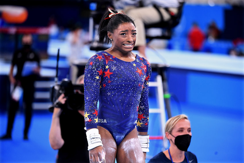 U.S. gymnast Simone Biles reacts after competing on the uneven bars in the women's team qualifying at the 2020 Tokyo Olympics on Sunday, July 25, 2021. (Wally Skalij/Los Angeles Times/TNS)