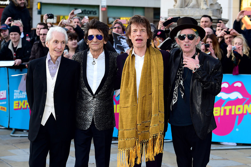 From left, Charlie Watts, Ronnie Wood, Mick Jagger and Keith Richards of The Rolling Stones on April 4, 2016, in London. Watts has died at age 80. (Ian West/PA Wire/Zuma Press/TNS)
