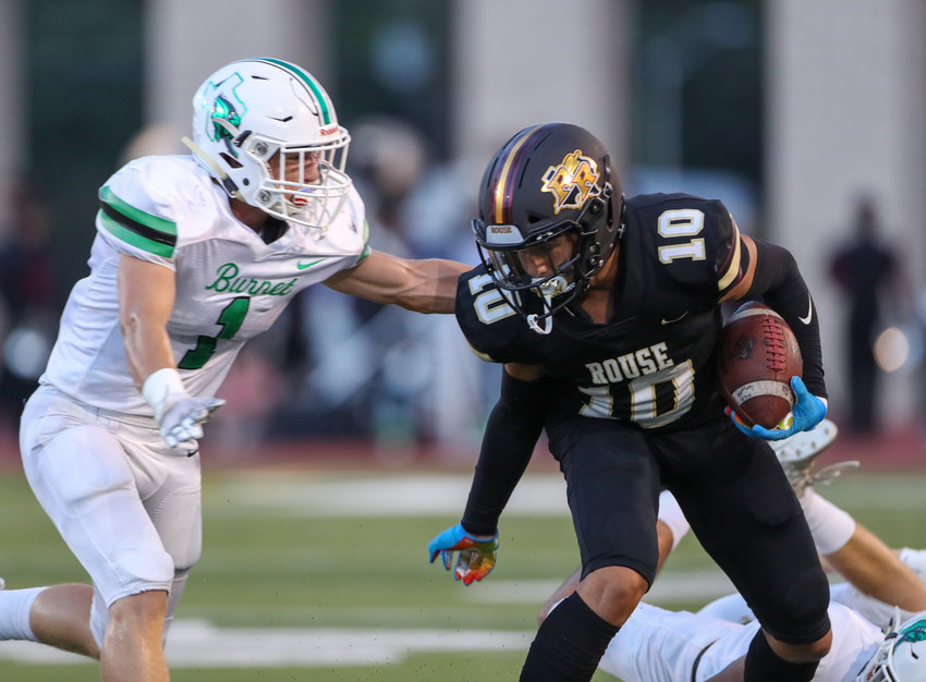Rouse Raiders senior wide receiver Jalen Becerra (10) carries the ball during a high school football game on August 25, 2021 in Leander, Texas.