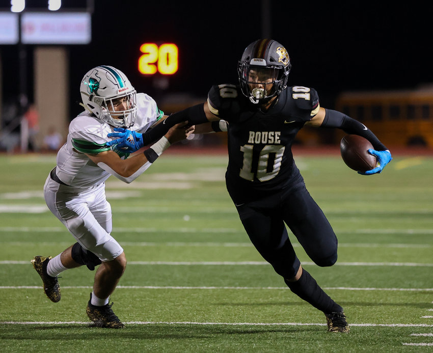 Rouse Raiders senior wide receiver Jalen Becerra (10) carries the ball after a reception during a high school football game on August 25, 2021 in Leander, Texas.