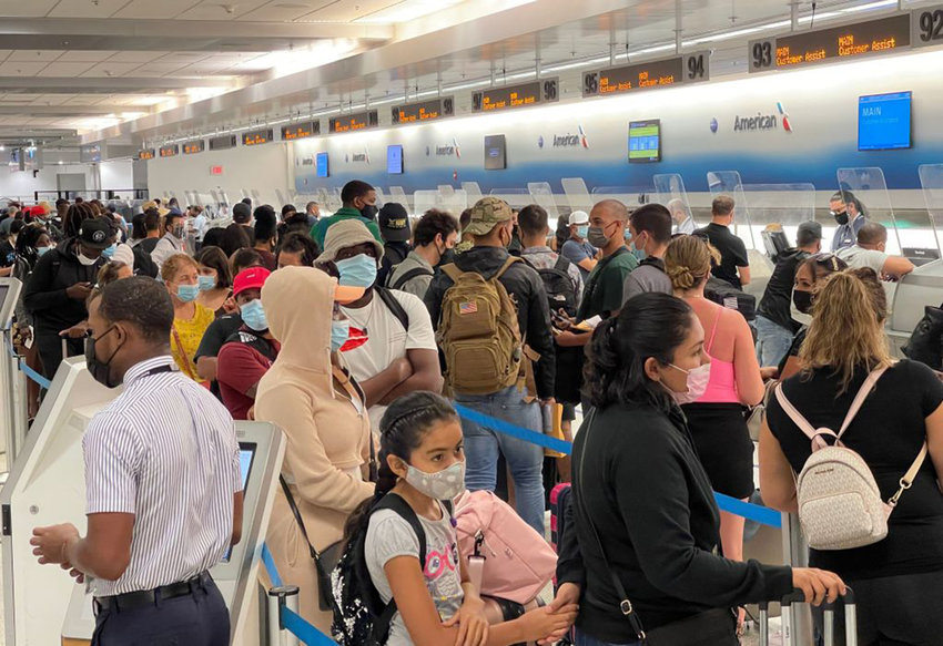 Travelers line up by the American Airline departure check in desks at Miami International Airport (MIA) on August 2, 2021. (Daniel Slim/AFP via Getty Images/TNS)