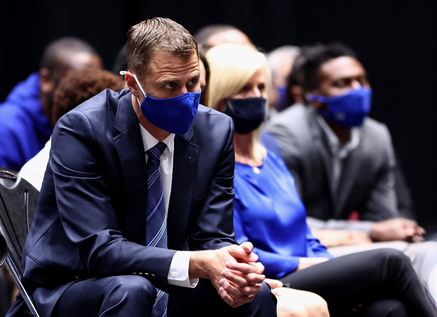 Assistant coach Jon Scheyer of the Duke Blue Devils listens during a press conference announcing the retirement of head coach Mike Krzyzewski at Cameron Indoor Stadium on June 3, 2021 in Durham, North Carolina. Krzyzewski, the winningest coach in Division I men's basketball history who led the Blue Devils to five national titles, announced he plans to retire after the 2021-2022 season. (Grant Halverson/Getty Images/TNS)