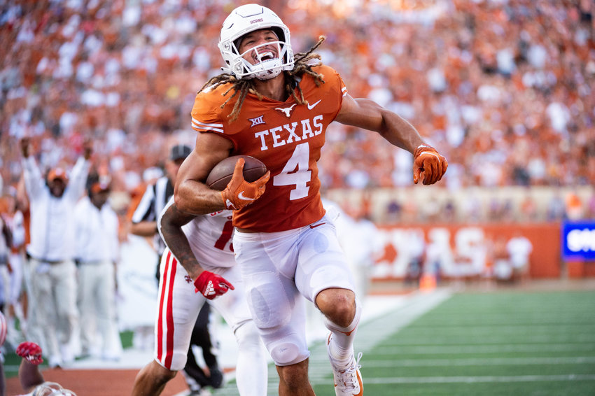 Jordan Wittington caught a touchdown in Texas' lopsided win against Texas Tech on Saturday. The Longhorns continue Big 12 play at TCU on Saturday.