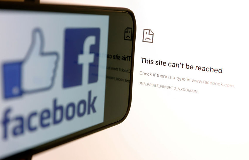 In this photo illustration, the Facebook logo is displayed next to a screen showing Facbook service down on Oct. 4, 2021. (Justin Sullivan/Getty Images/TNS)