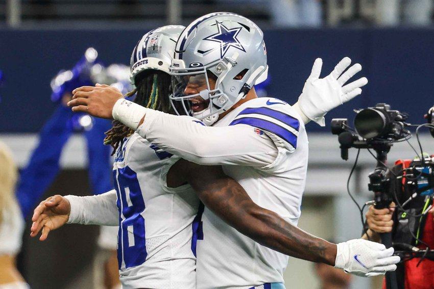 Dallas Cowboys' quarterback Dak Prescott (4) celebrates with CeeDee Lamb (88) after a touchdown during the first half of the game against New York Giants at AT&T stadium in Arlington on Sunday, October 10, 2021. (Lola Gomez/The Dallas Morning News)