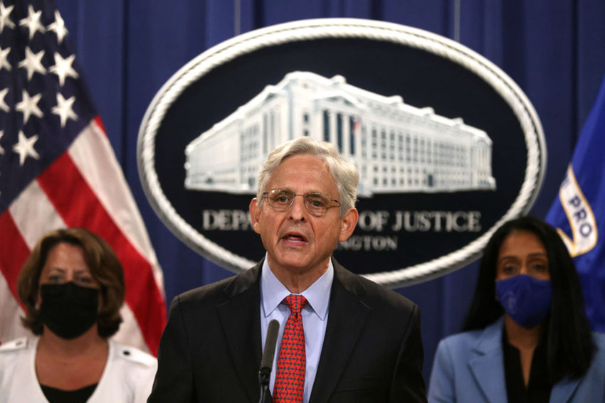 U.S. Attorney General Merrick Garland (center) speaks as Deputy Attorney General Lisa Monaco (left) and Associate Attorney General Vanita Gupta (right) listen during a news conference to announce a civil enforcement action at the Department of Justice on Sept. 9, 2021 in Washington, DC. (Alex Wong/Getty Images/TNS)