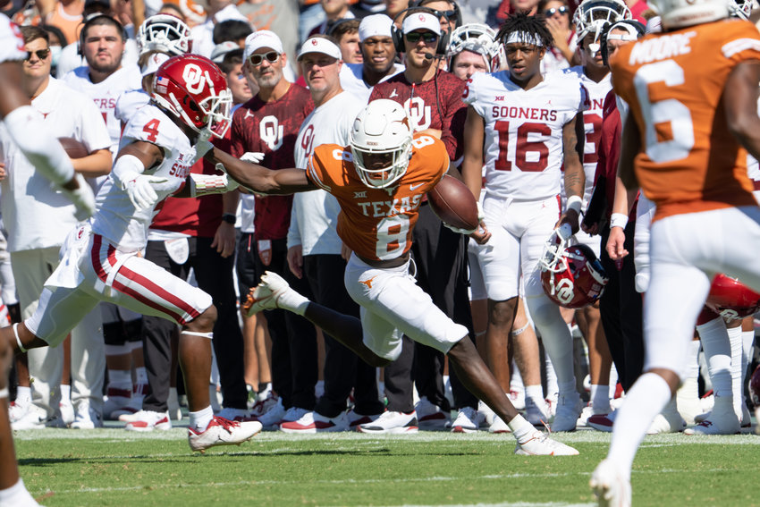 Xavier Worthy caught nine passes for 261 yards and a touchdown in Texas' 55-48 loss to Oklahoma Saturday at the Cotton Bowl in Dallas.
