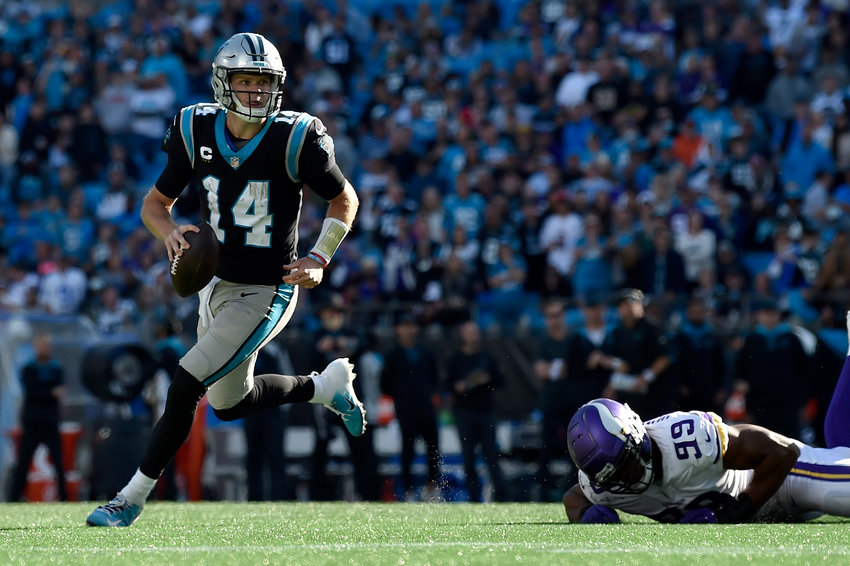 Sam Darnold (14) of the Carolina Panthers runs out of the pocket during the fourth quarter against the Minnesota Vikings at Bank of America Stadium on Sunday, Oct. 17, 2021 in Charlotte, North Carolina. (Mike Comer/Getty Images/TNS)