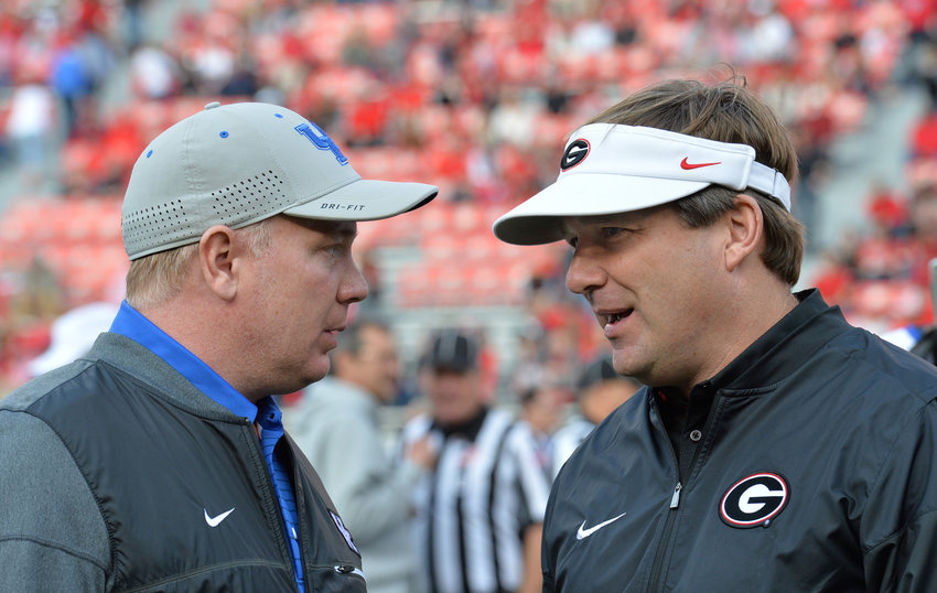 Georgia head coach Kirby Smart, right, and Kentucky head coach Mark Stoops talk before the start of a game on Nov. 18, 2017, in Athens, Ga. (Hyosub Shin/Atlanta Journal-Constitution/TNS)
