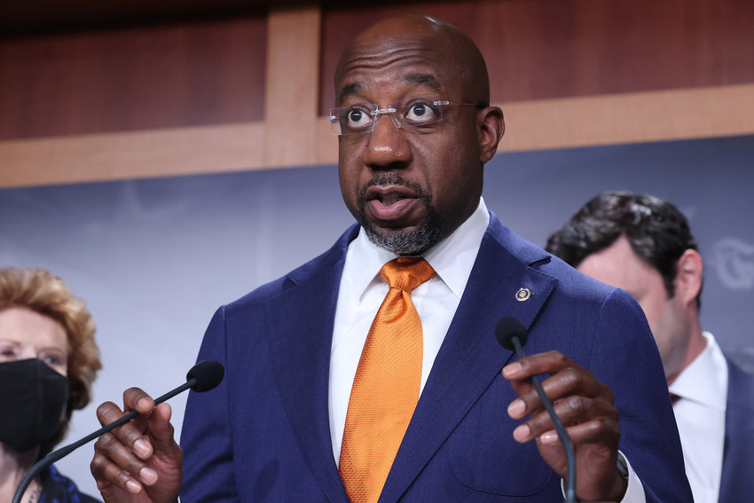 U.S. Sen. Raphael Warnock (D-Georgia) and other Democratic members of Congress hold a news conference  to push for a solar tax credit at the U.S. Capitol on Sept. 28, 2021 in Washington, D.C. (Chip Somodevilla/Getty Images/TNS)