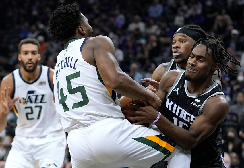 The Sacramento Kings' Davion Mitchell #15 strips the ball away from the Utah Jazz' Donovan Mitchell (45) during the second quarter at Golden 1 Center on Friday, Oct. 22, 2021, in Sacramento, California. (Thearon W. Henderson/Getty Images/TNS)