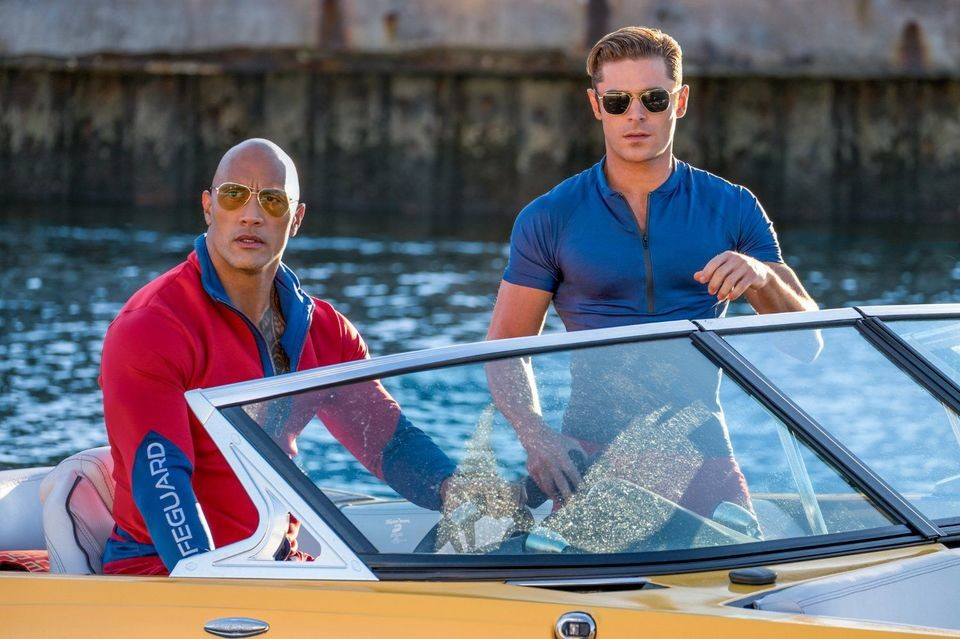 "Dwayne Johnson and Zac Efron star in the big screen revival of 90s television hit ""Baywatch,"" in area theaters now."