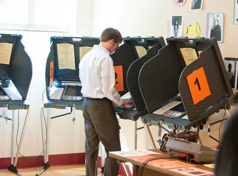 A voter casts his ballot in a 2014 election.