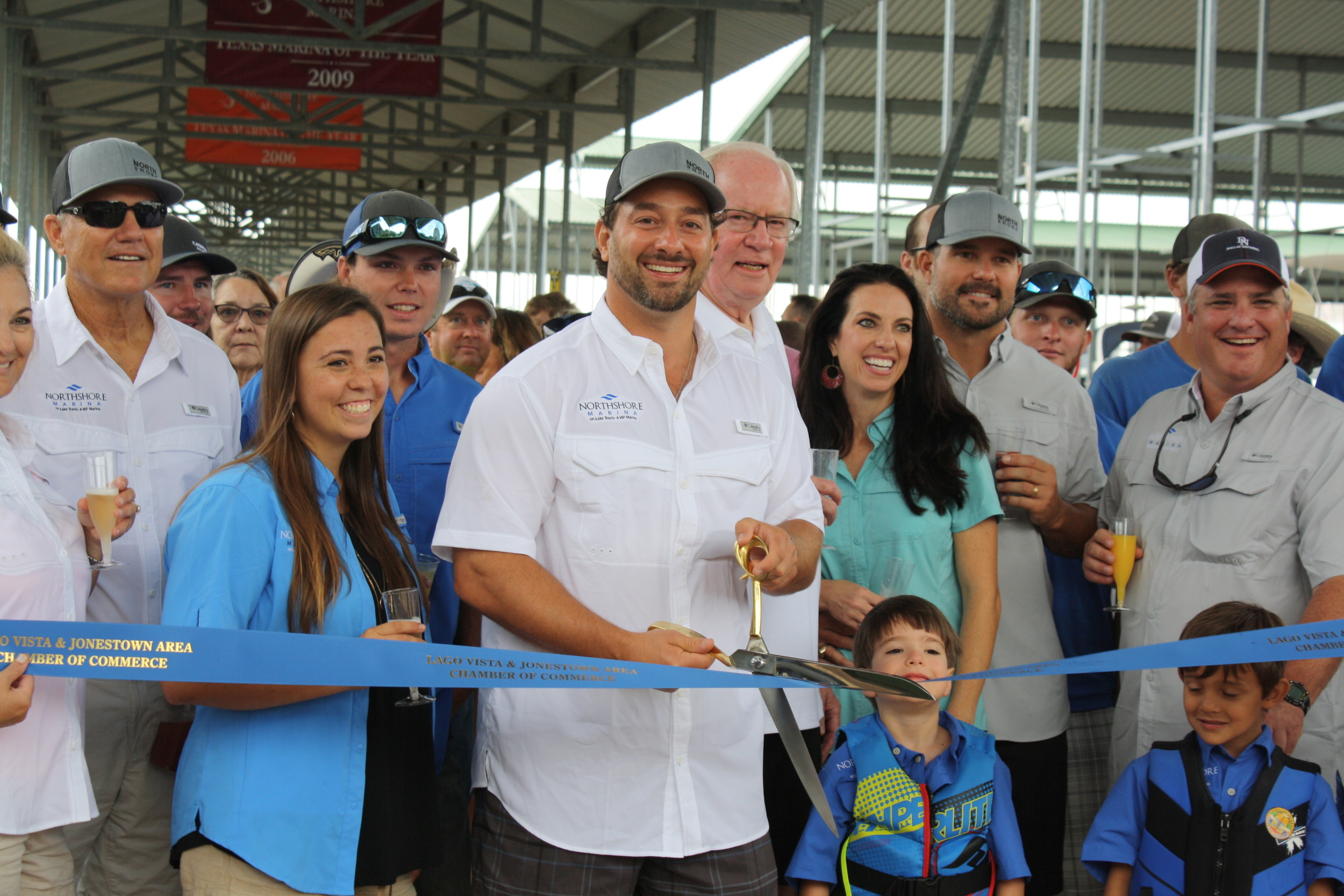 Austin Cameron, owner of NorthShore Marina, cuts the ribbon at the celebration for the marina's expansion of 71 new boat slips, Saturday, June 24.