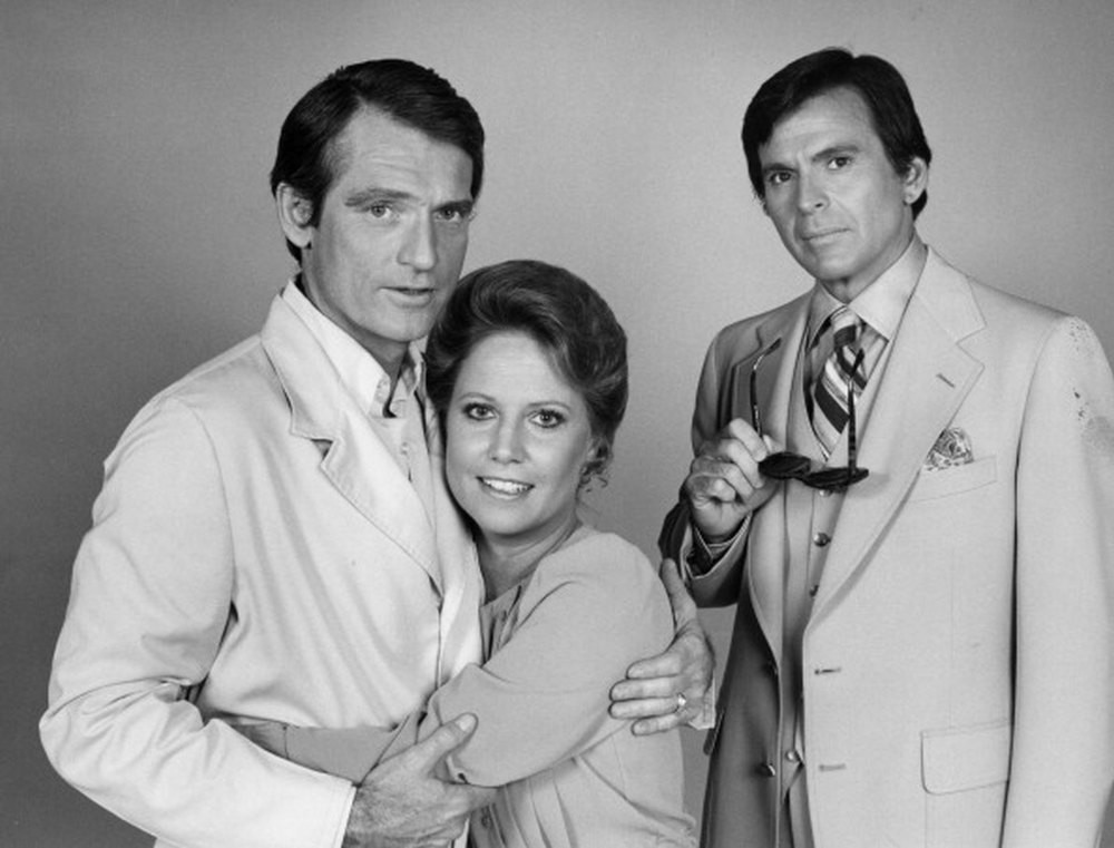 Chris Robinson as Dr. Rick Webber, left, Leslie Charleson and Stuart Damon in  General Hospital.