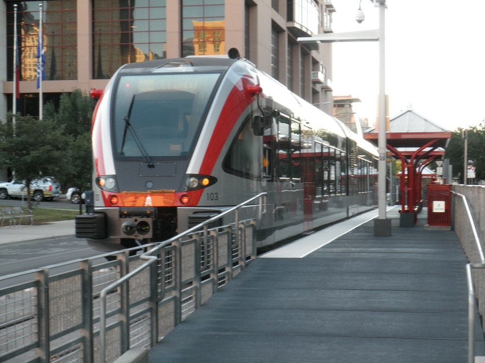 A Capital Metro Red Line train sits at the Downtown Austin station.