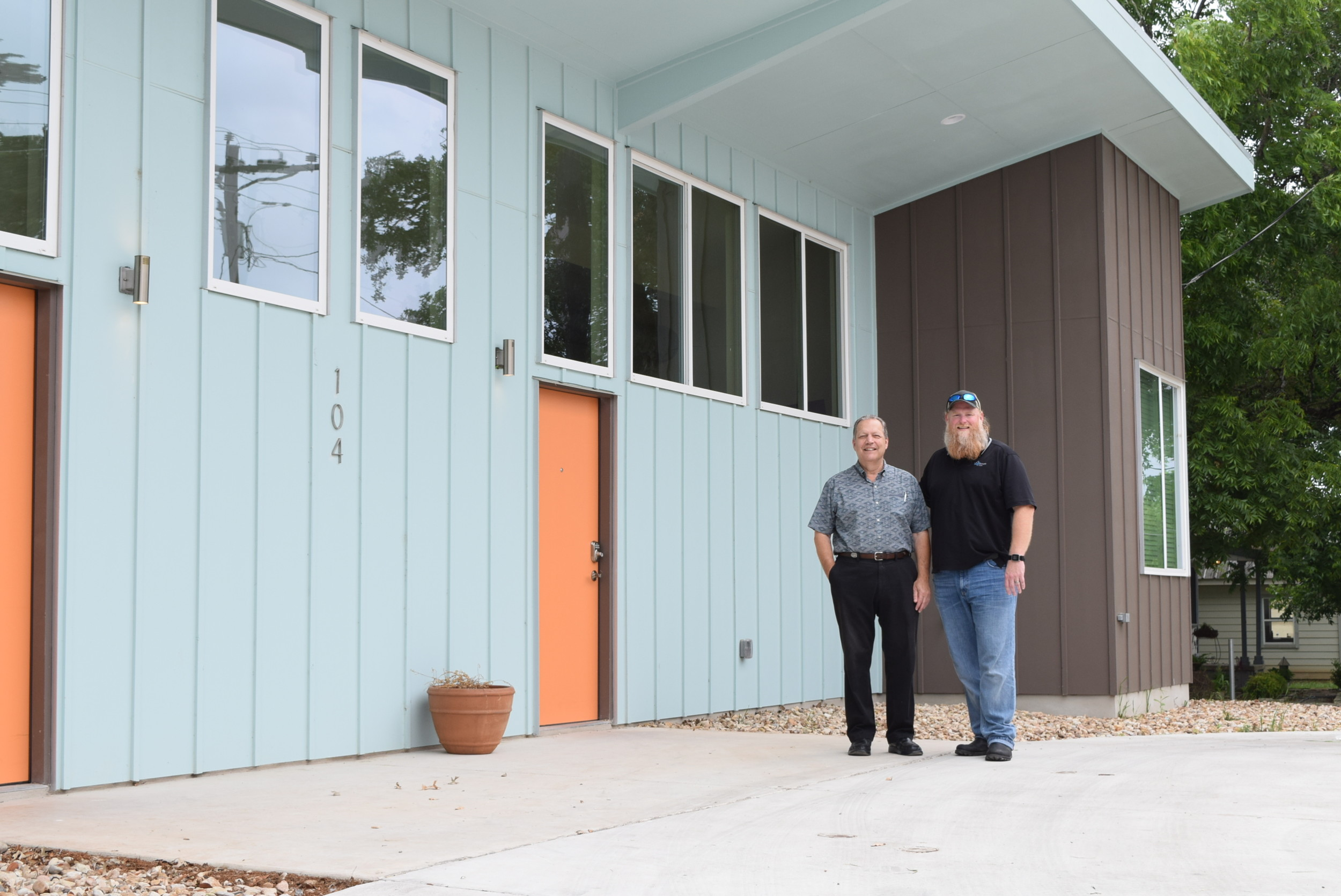 Development director, Erland Schulze (left), and executive director, David Gould, stand outside the Hope House duplex on Young Street in Liberty Hill.