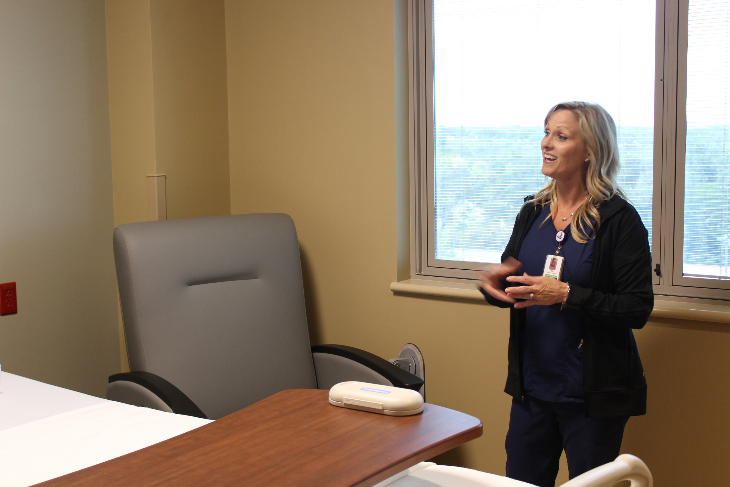 Stacey Williams, orthopedics coordinator, showcases how the Joint and Spine Center's private rooms cater to families.