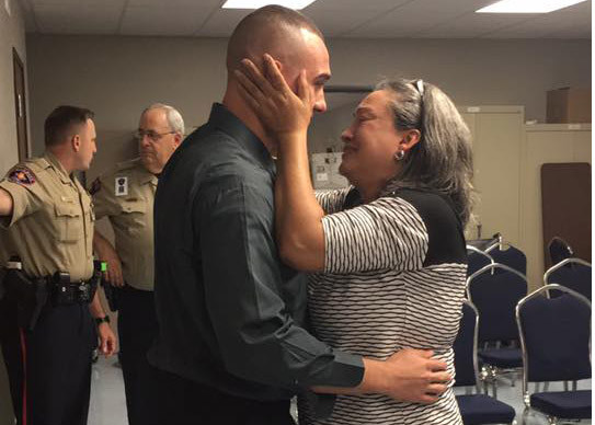 With Williamson County sheriff's officers looking on, Greg Kelley embraces his mother, Rosa, at the hearing into whether he was wrongly convicted last week. Rosa Kelley has fought for four years to help Kelley prove his innocence.