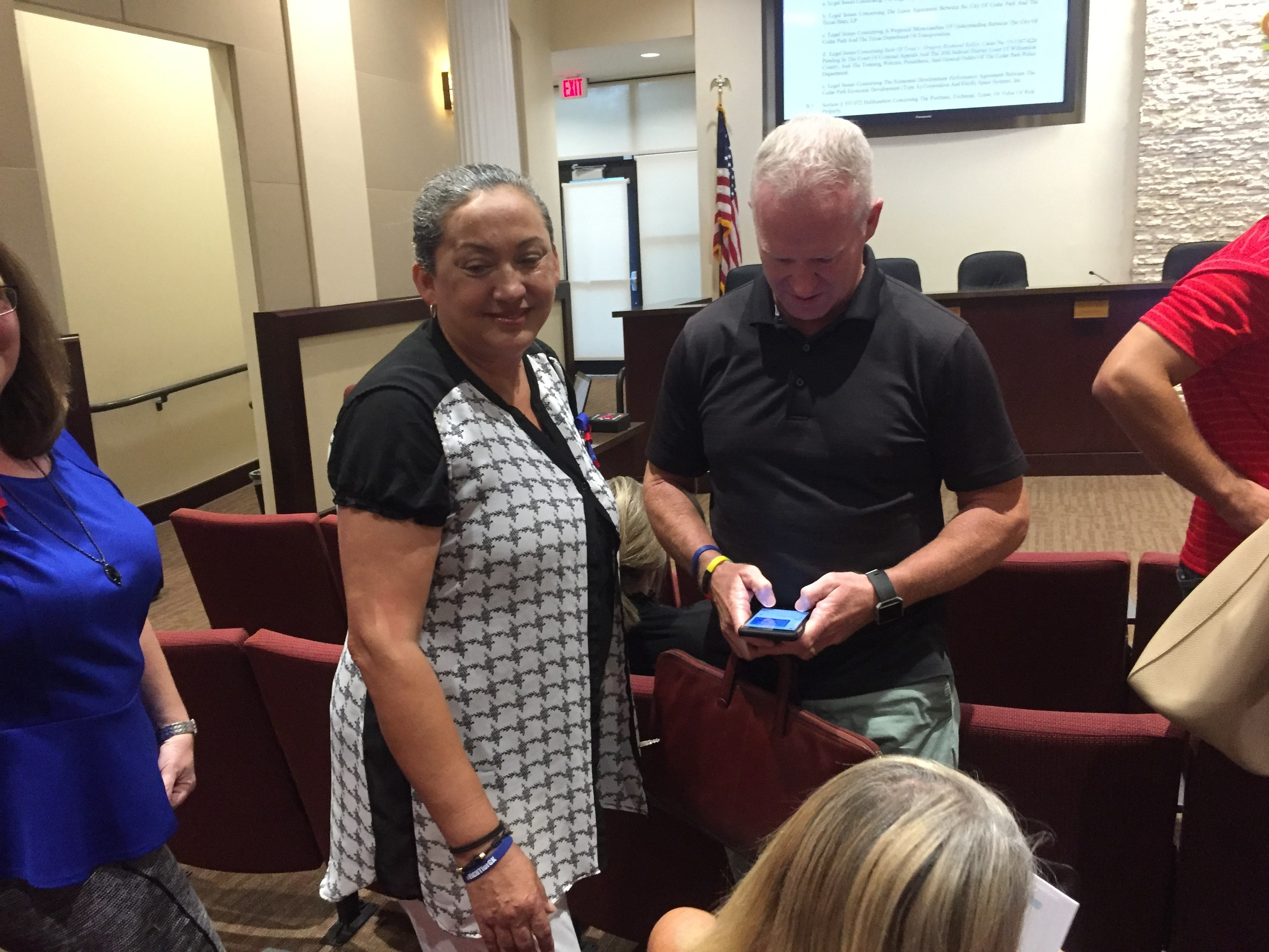 Rosa Kelley, left, the mother of Greg Kelley, talked with supporters during a recess at the Cedar Park City Council meeting Thursday night. Kelley made an impassioned plea for the firing of the police chief and the lead police investigator for their roles in the Kelley investigation.