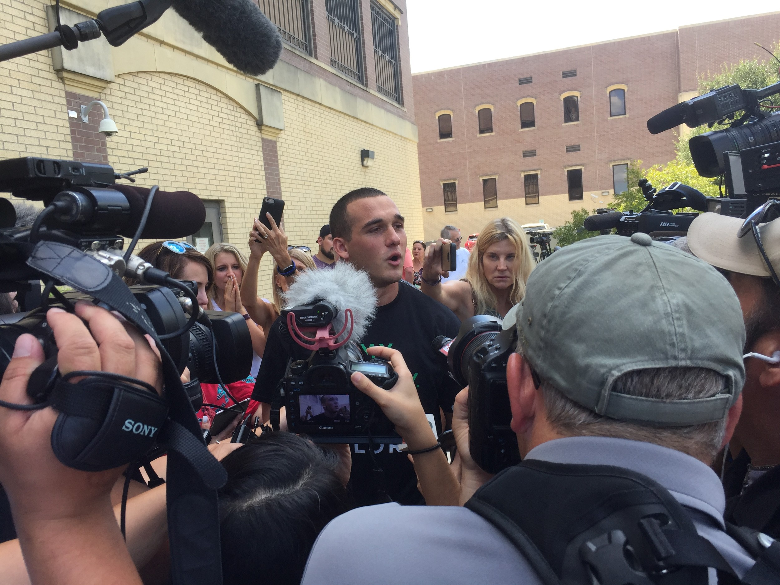 Greg Kelley was greeted by a throng of supporters and reporters Thursday after his release from jail, Aug. 22, 2017.