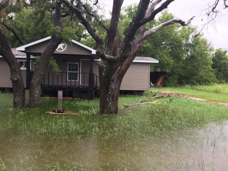 This house in the Ranchettes by Blockhouse Creek, and many others in the neighborhood, saw flood waters swamp their lawns over the weekend.