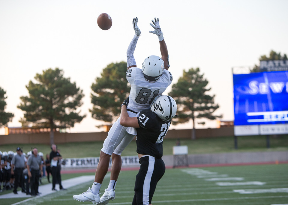 Vandegrift Vipers junior wide receiver Reese Watson (81) leaps for a would-be touchdown pass as Permian Panthers Seth Higdon (21) defends the play in the end zone during a high school football game between the Permian Panthers and the Vandegrift Vipers at Ratliff Stadium in Odessa, Texas, on Friday, September 1, 2017.
