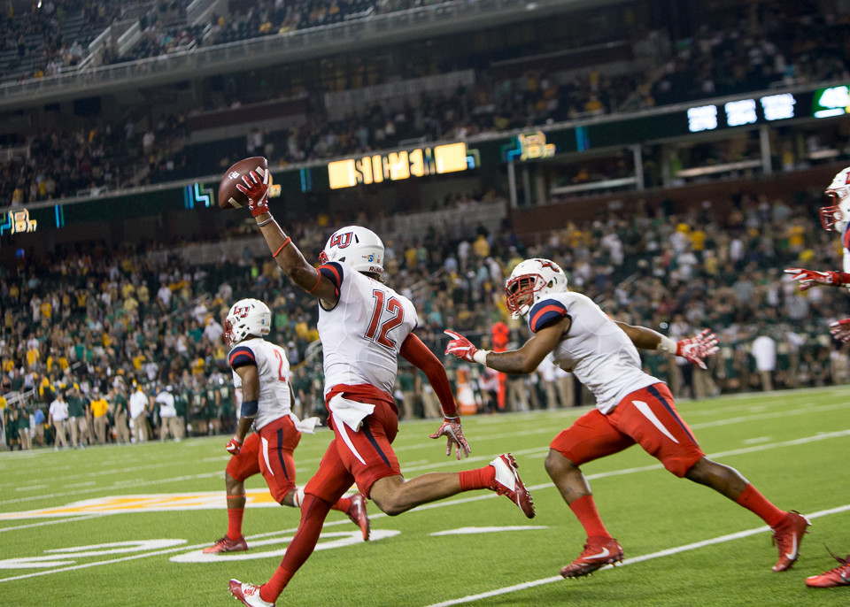 Liberty Flames safety Brandon Tillmon (12) celebrates after making a game-saving interception in the final moments of the college football game between the Baylor Bears and the Liberty Flames at McLane Stadium in Waco, Texas. Liberty won 48-45.